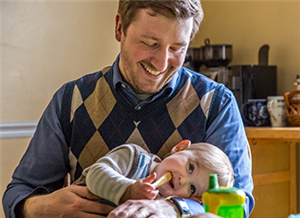Through an unlikely connection with diaconate program, couple fulfills dream to adopt a child
