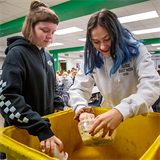 Yellow bins represent green efforts at Nerinx Hall