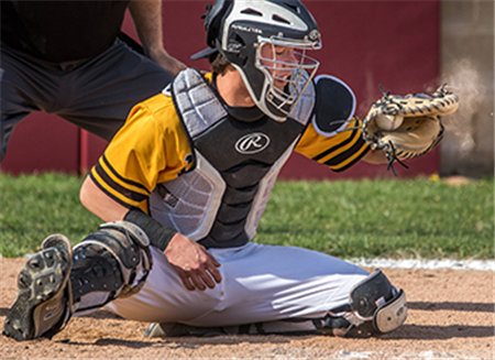 Vianney star catches baseballs, Catholic faith