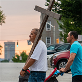 Taking Way of Cross through streets in Baltimore shows support for migrants, refugees