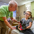 Deacon's love for dogs translates into smiles for pediatric patients at Mercy Hospital