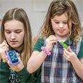 From paper bead bracelets to wooden toy cars, St. Roch students learn about resourcefulness of children in missions
