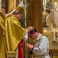 Archbishop Carlson ordains two men to sacred priesthood