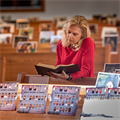Photos in the pews have elicited a sense of unity for parishioners, pastors alike