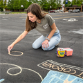 Home from college, St. Cletus parishioner spreads positivity through chalk art