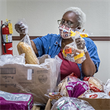St. Nicholas' St. Vincent de Paul food pantry distributes fans, food and more
