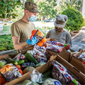 Catholic Charities assists a community in need through distribution of care packages