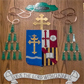 Retired woodworker Bill Kennebeck has enjoyed making several coats of arms for local bishops