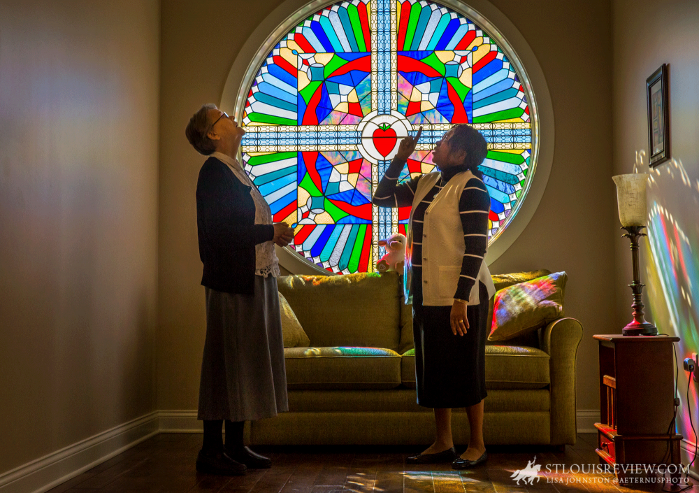 Sister Ita Harnett, postulant director for the Sisters of Charity of the Incarnate Word novitiate in St. Louis, looked at the colors coming off the stained glass with formation director Sister Helena Adaku Ogbuji. The Sisters of Charity recently completed consolidation of novitiates from Kenya and Guatemala into the novitiate in St. Louis.