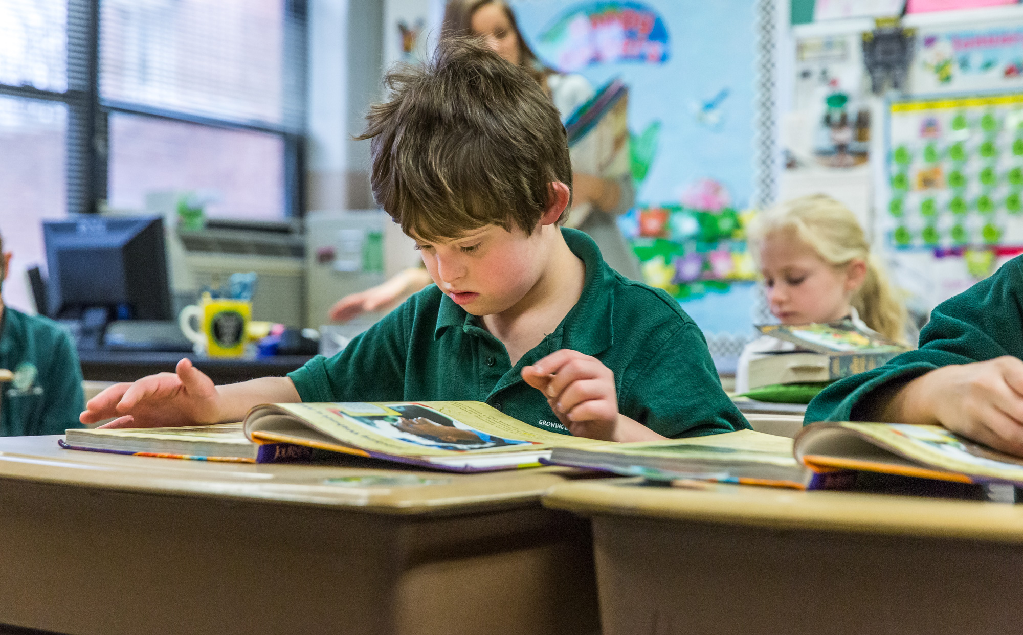 Third-grader Aiden Hadican read with his classmates Jan. 23 at Incarnate Word School. After careful study over the past three years, Incarnate Word School began an inclusion program, accepting three students with Down Syndrome, including Aiden.