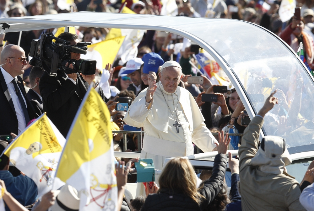 Pope Francis greeted the crowd before celebrating Mass Jan. 17 at the Maquehue Airport near Temuco, Chile.