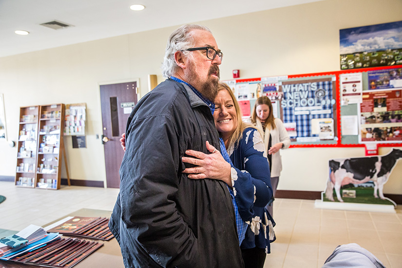 Mark Sienkiewicz, who survived a heart attack he had while attending an event at St. Simon the Apostle Parish, hugged Denise Buehler, one of the teachers who revived him with an AED (automated external defibrillator). Sienkiewicz's doctor told him that if there hadn't been an AED present, he probably would not have survived.