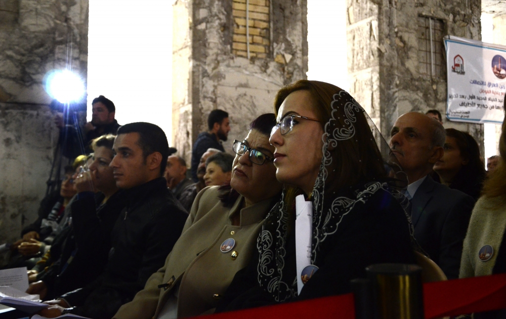 Chaldean Christians in Mosul, Iraq, attend Christmas Mass at St. Paul Cathedral Dec. 24.