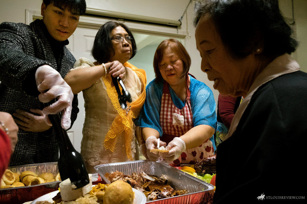 Parishioners Kevin Eulalia, left, Fely Eulalia and Merlinda Eulalia served Filipino delicacies after a Simbang Gabi Mass Dec. 18. Simbang Gabi is a novena of Masses honoring Mary. The tradition of Simbang Gabi traces back to the arrival of Spanish missionaries in the Philippines about 500 years ago. At the time, they had a tradition of celebrating pre-Christmas novena Masses in honor of the Annunciation.