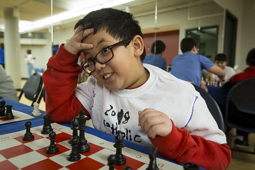 Raiden Nguyen of St. Frances Cabrini Academy played chess Jan. 27 at the Billiken Teacher Corps' Catholic School Olympics at St. Louis University. Members of the Billiken Teacher Corps brought students from eight schools to participate in various events to open Catholic Schools Week.