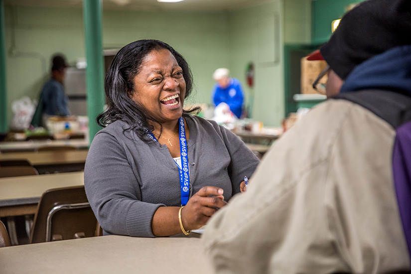 Eddiemae Brown is a volunteer for the St. Vincent de Paul Society at Our Lady of the Holy Cross Parish in the Baden neighborhood of north St. Louis. She helped a client on April 17.
