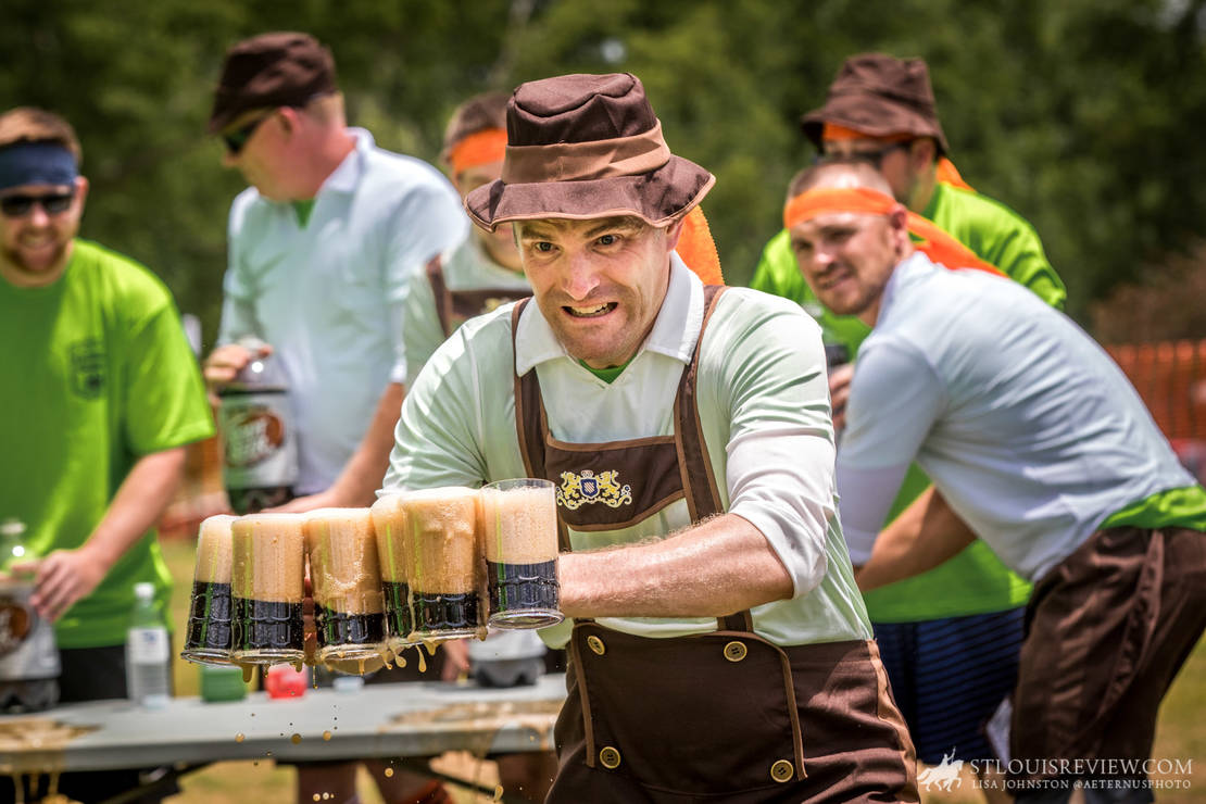 Father Timothy Foy raced with six mugs of root beer across the course as he tried not to spill them during the German Games at St. John the Baptist 'Gildehaus' Parish on June 23.