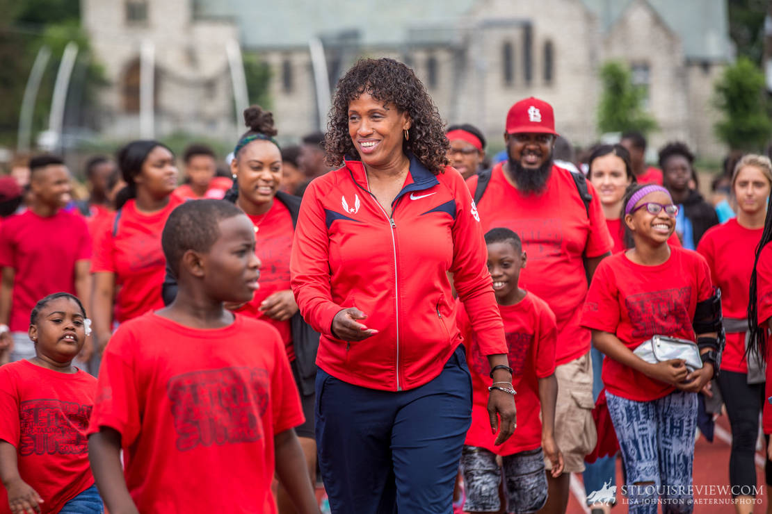 Jackie Joyner-Kersee jogged along with runners at Francis Field on June 22. Joyner-Kersee was speaking at an Olympic Day held at Washington University.