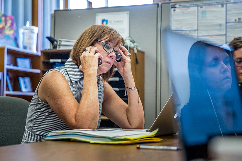 Amy Hirsch Diemer, St. Francis Community Services managing attorney, made a phone call as the Southside Center team worked to understand the latest U.S. government policy and help their clients navigate legal issues.