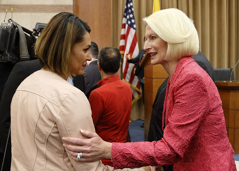 Salwa Khalaf Rasho, a human rights activist who escaped Islamic State captivity, talked with Callista Gingrich, U.S. ambassador to the Vatican, during a symposium on religious freedom presented by the U.S. Embassy to the Holy See in Rome June 25.