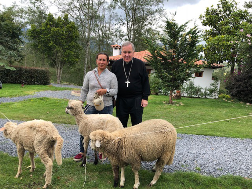 Archbishop Robert J. Carlson visited the Messengers of Peace community in Colombia. With a $5,000 grant from the Archbishop's Charity Fund, the Messengers of Peace have started a program to give sheep to people in need to use as a source of income.