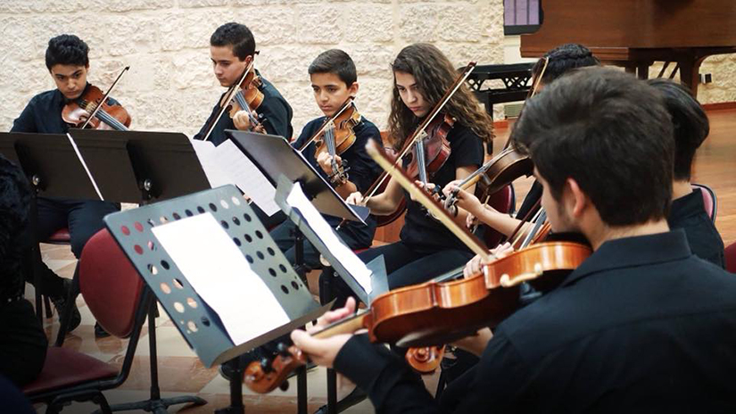 Members of the Franciscan-run Magnificat Institute Jerusalem perform in an undated photo. The institute, which opened in 1995, offers young people serious music education and study, regardless of religious background.