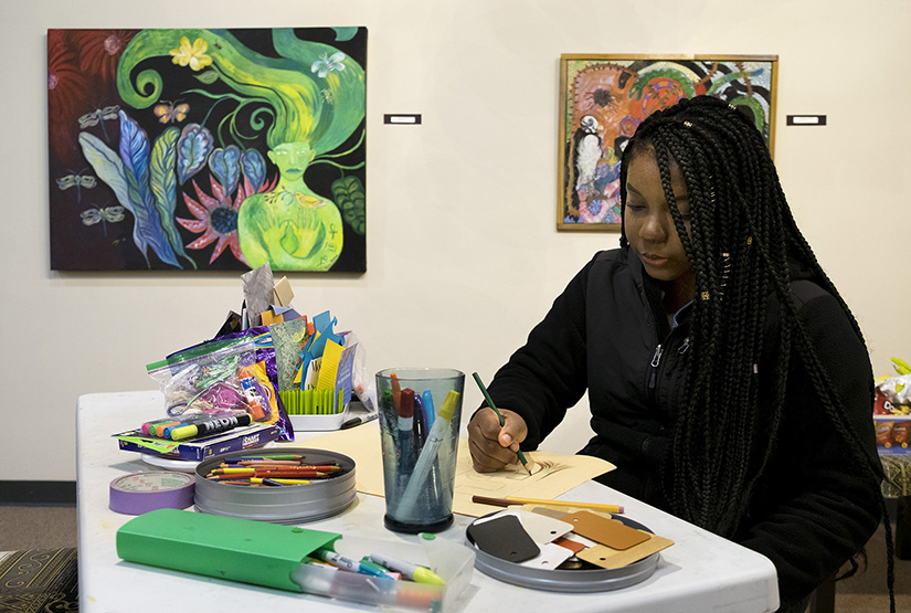 "Nadia Sharif, a senior at Hazelwood West High School, sketched during an evening of ""art storming"" at Good Shepherd Arts Center in Ferguson. The ""art storming"" was a way to come up with artistic ideas for a show set for August at multiple venues in and around Ferguson."
