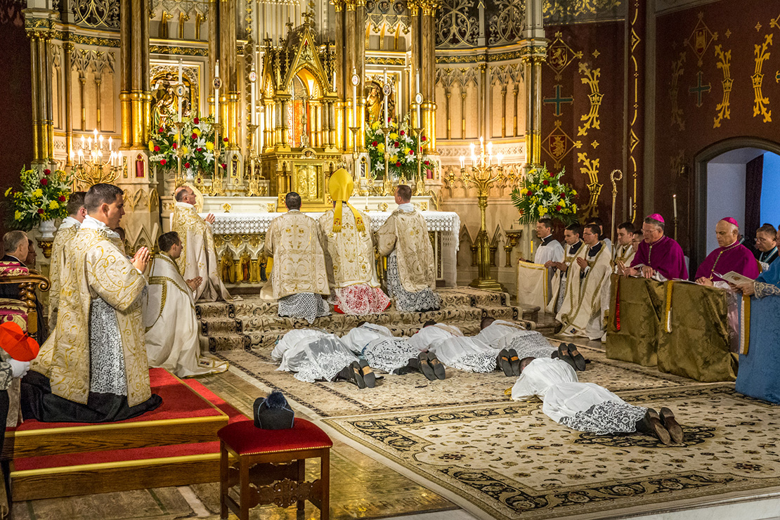 Cardinal Raymond L. Burke ordained Canons Peter Heidenreich, Benjamin Norman, Matthew Weaver and Luke Zignego to the priesthood for the Institute of Christ the King Sovereign Priest Aug. 2 at the Oratory of Saint Francis de Sales. The men lay prostrate on the floor during the Litany of Saints.