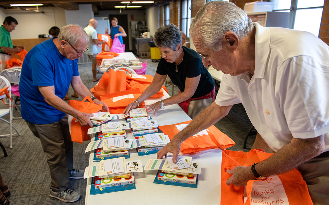 Richard Nix, right, began Books for Newborns with several other people to address the connection between a lack of literacy and poverty. The nonprofit provides low-income mothers with a free tote bag filled with four new books, along with resources to help mothers bond with their children.