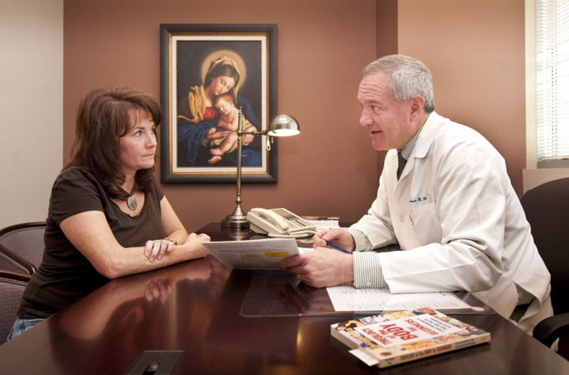 Angela Mandziuk reviewed her Creighton Model chart with OB/GYN Dr. Richard Brennan at his office at SSM St. Clare Health Center in Fenton. Mandziuk, a parishioner at St. Gianna in Lake St. Louis and the mother of three girls, learned about Brennan through a prayer chain.