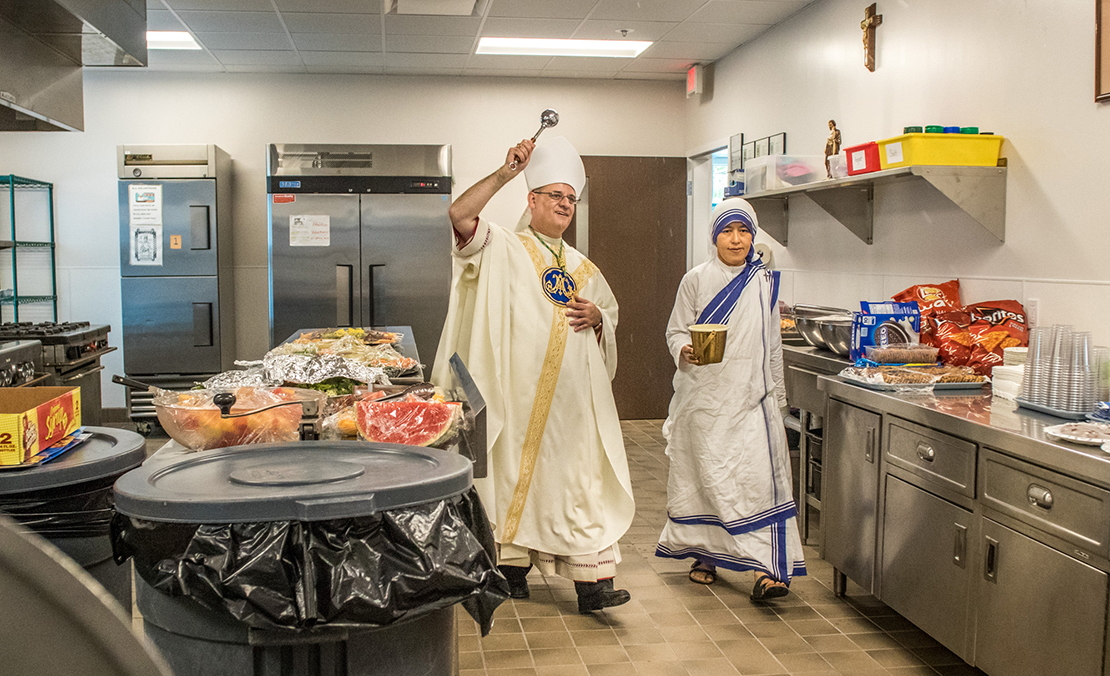 Sister M. Jonathan, Midwest regional superior, assisted Auxiliary Bishop Mark S. Rivituso as he blessed the new Missionaries of Charities' soup kitchen in north  St. Louis after Mass Aug. 16.