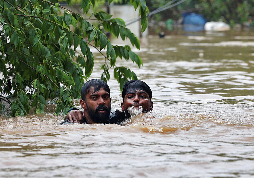 Rescuers saved a man from drowning Aug. 16 after the opening of a dam following heavy rains on the outskirts of Cochin, India. The Catholic Church has joined relief efforts as unprecedented floods and landslides continue to wreak havoc in India's Kerala state, killing more than 350 people.