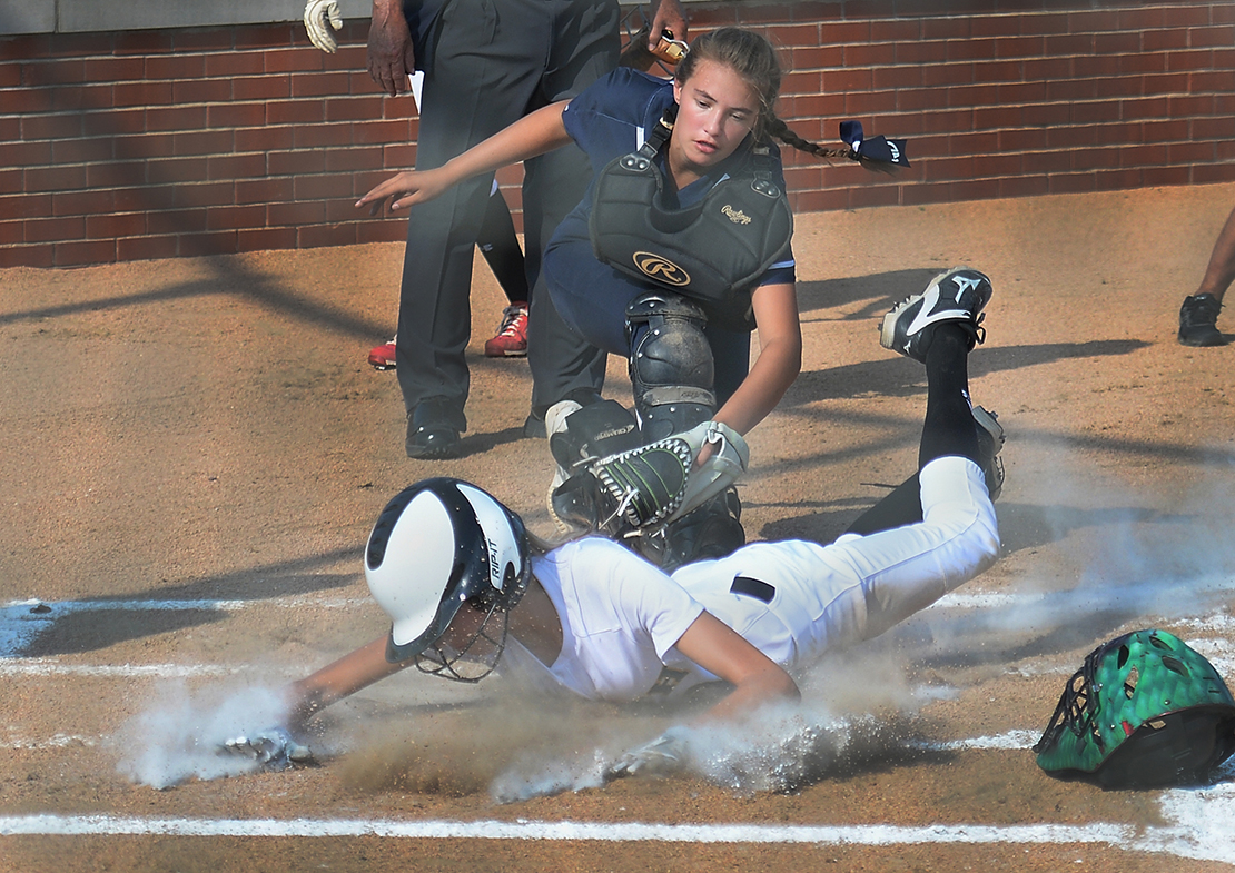 Samantha Foppe of Notre Dame tagged out Emma Heskett of Lutheran South in the second inning at Lutheran High School South on Aug. 27 in Kirkwood.