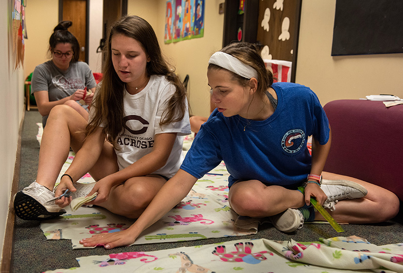 Villa Duchesne students Maria Adamitis, left, and Clare Eisenbeis worked on blankets to be distributed to the needy during the school's Global Service Day Sept. 15 in Frontenac. The service day, involving 147 Sacred Heart Schools in 33 countries, marked the 200th anniversary of St. Rose Philippine Duchesne opening the first Sacred Heart School in North America. Participants filled and delivered blessing bags with essential personal supplies, cleaned up campus and volunteered at the St. Louis Area Foodbank.