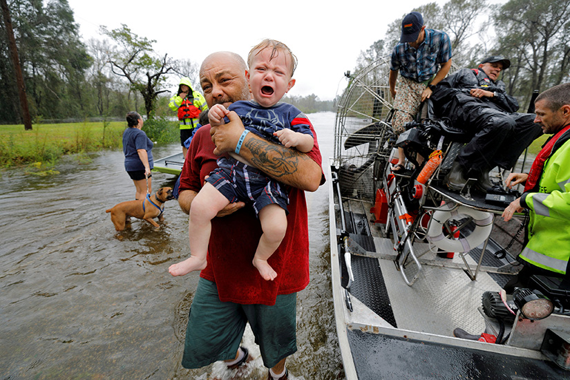 One-year-old Oliver Kelly cried as he was carried off a sheriff's airboat in Leland, N.C., during a rescue Sept. 17 from rising floodwaters in the aftermath of Hurricane Florence. The storm dumped record rainfall on the Carolinas, causing record flooding in many areas of the states.