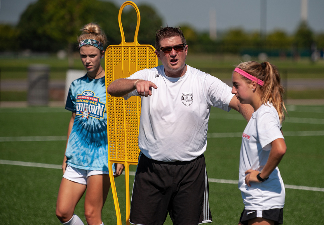 Jeff Muhr, director of coaching and player development for the Missouri Youth Soccer Association, coaches players during a pre-tryout training session for players participating in the Olympic Development Program at Creve Coeur Park Soccer Complex in Maryland Heights.