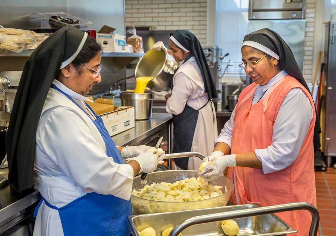 "From left, Sister Assumpta Kurisunkal, Sister Rufina ""Ruby"" Devassy Kappithanparambil and Sister Lissy Ouseph Vazhakkoottathil prepared food in the Kenrick-Glennon Seminary kitchen on Sept. 13. The Sisters of the Congregation of the Carmelite Religious, from Trivandrum in the Indian state of Kerala, take care of Kenrick-Glennon seminarians by praying with them and cooking meals."