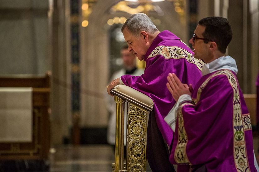 Archbishop Robert J. Carlson prayed at the end of a Mass of Reparation Sept. 7 at the Cathedral Basilica of Saint Louis.