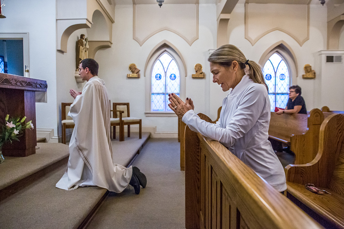 "Barb Kelley starts her day at 4 a.m. with prayer and then attends morning Mass at Ascension Parish's ""Little Church."" She knelt in the front pew as Father Michael Lampe prayed the St. Michael prayer following Mass on Oct. 2. In healing from her own divorce, Kelley said she needed ""God my Father and my Redeemer in my life."""