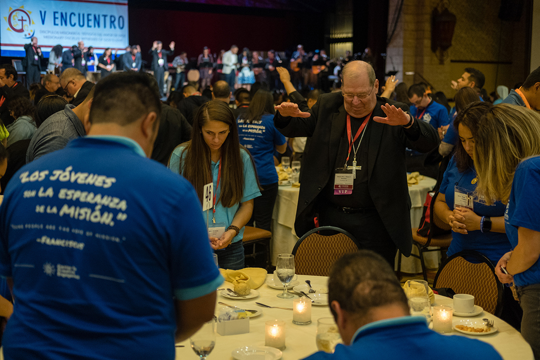 Bishop Robert P. Deeley of Portland, Maine, prayed with young adults Sept. 21 at an evening encounter at the Fifth National Encuentro in Grapevine, Texas. The dinner brought together more than 700 Catholic young adults and a cross section of the 150 bishops attending the national event.