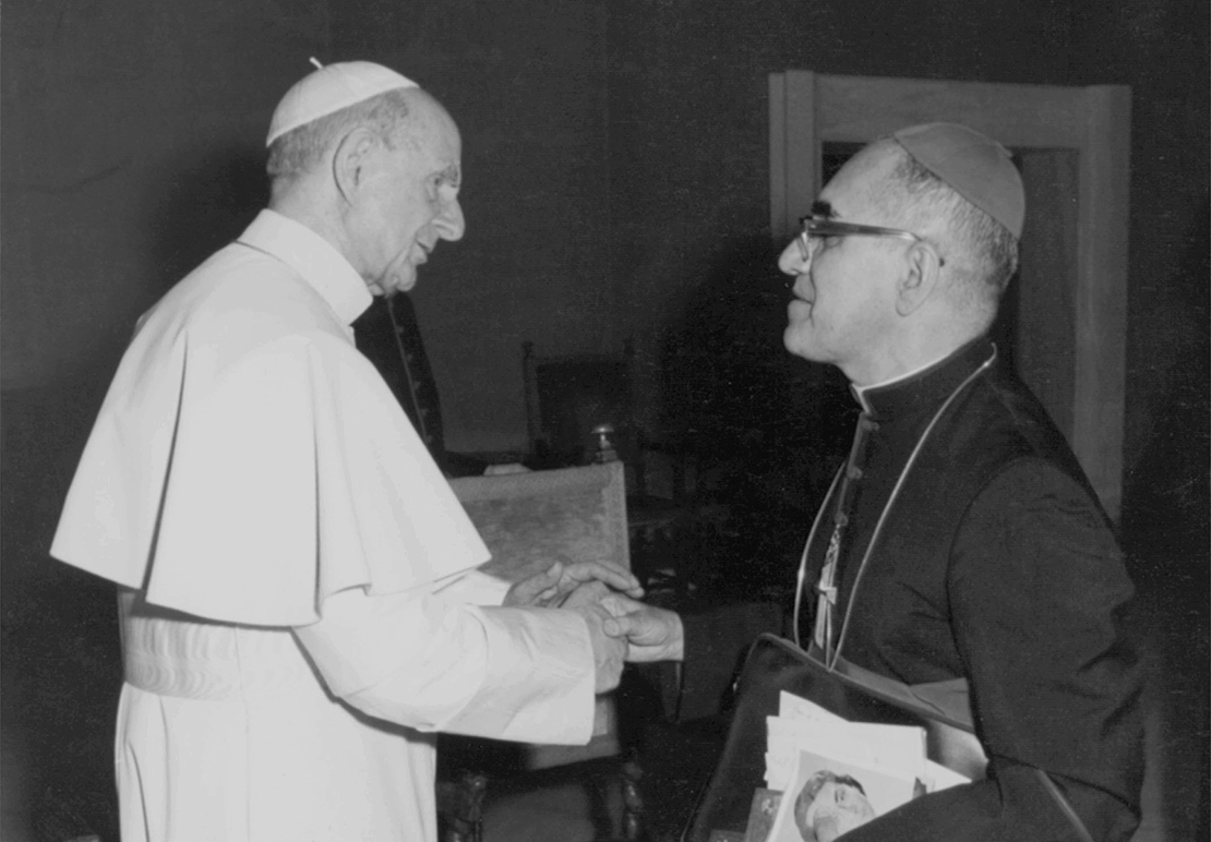 Blesseds Paul VI and Oscar Romero, who are both among seven new saints Pope Francis was to canonize Oct. 14 at the Vatican, talked with each other in an undated photo.