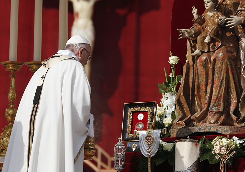 Pope Francis venerated relics as he celebrated the canonization Mass for seven new saints in St. Peter's Square at the Vatican Oct. 14.