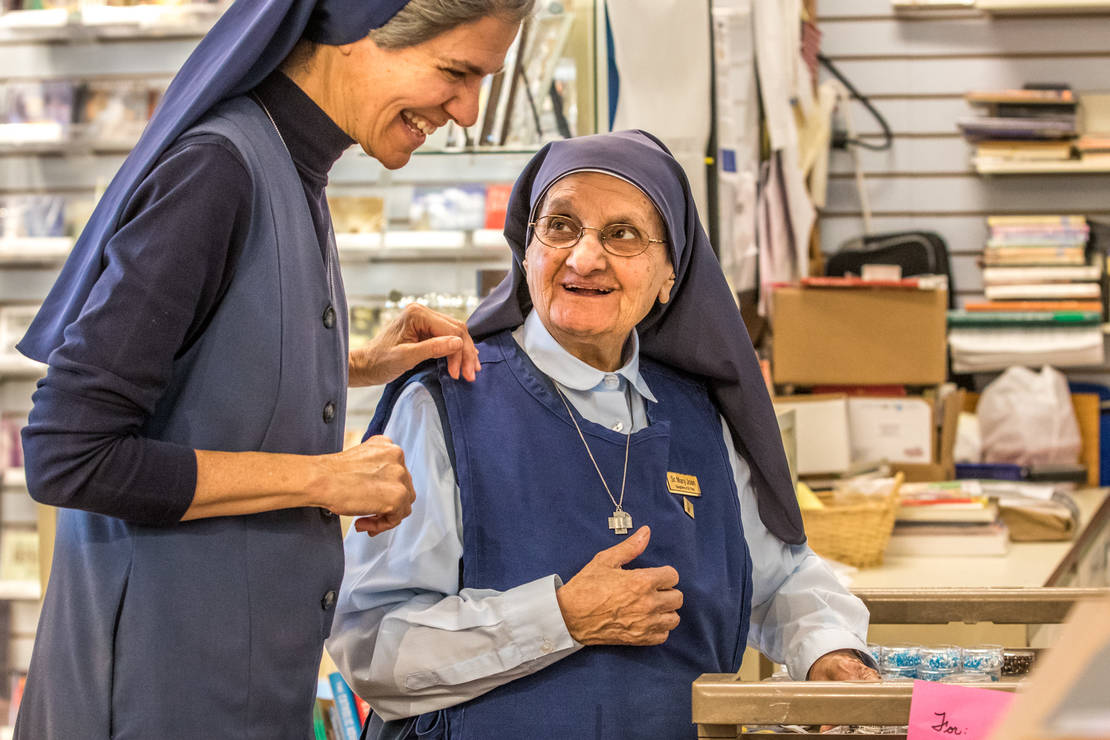 Sister Mary Joan Baldino, FSP, right, at age 89, is past the standard retirment age, but still finds time to serve at Pauline Books & Media in Crestwood. She priced rosaries with Sister Laura Brown, FSP, on Oct. 23 at the store.