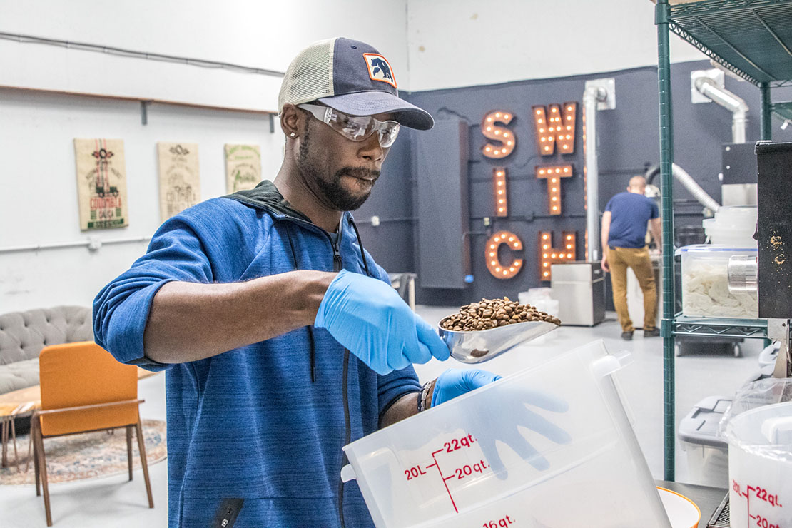 Jerry Henderson measured coffee beans at Switch Coffee Collective. Henderson had struggled finding work after leaving prison and was assisted by Mission: St. Louis, a nonprofit organization to equip men with job training and employment opportunities. His relationship with Mission: St. Louis led to his employment with Switch.