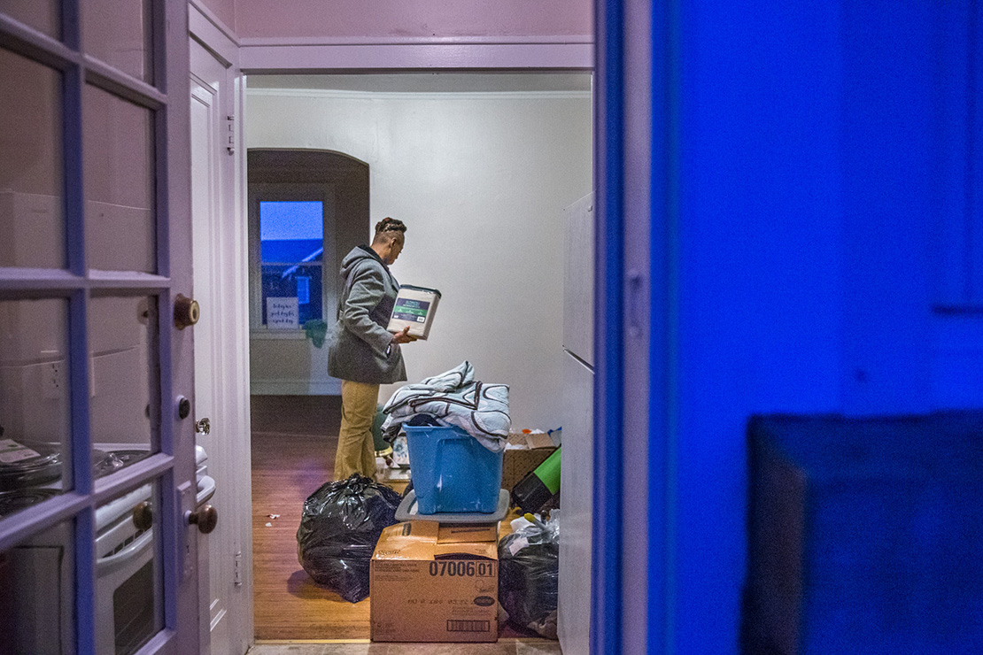 Tracy Stanton unloaded boxes and bags of her possesions as she was moving to her own apartment in south St. Louis from a transitional housing unit operated by the Center for Women in Transition.