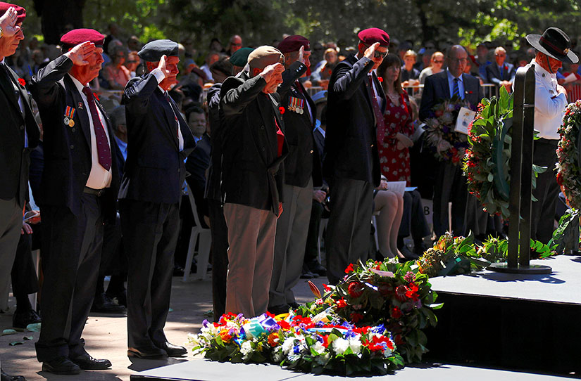 Representatives of ex-service organizations saluted after laying wreaths at a memorial service at the ANZAC War Memorial to mark the centenary of the armistice ending World War I, in Sydney, Nov. 11.