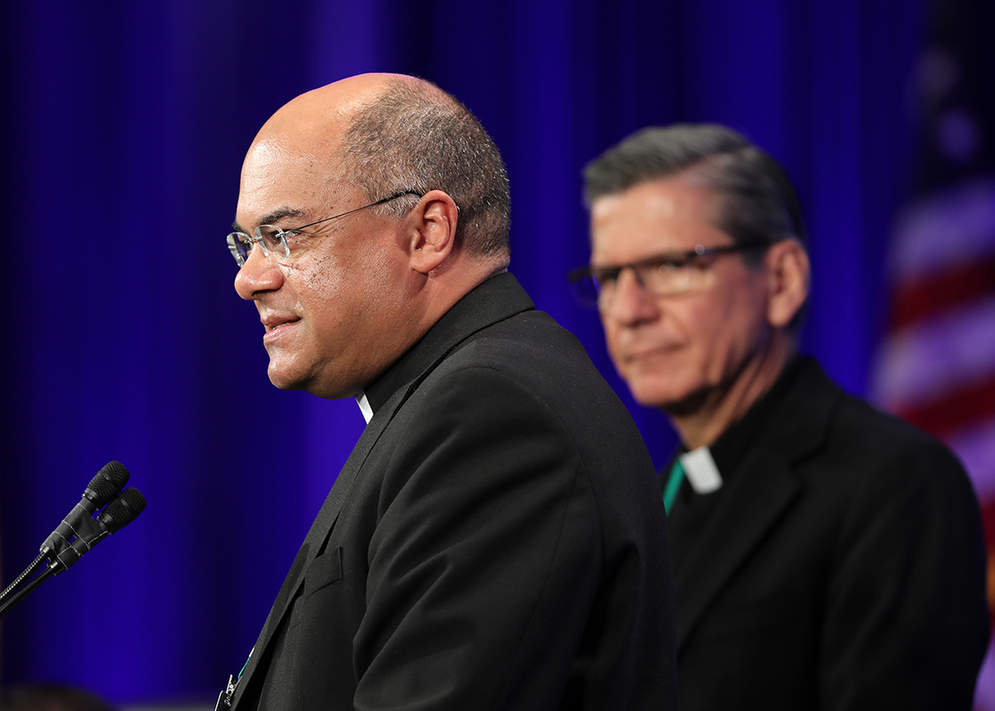 Bishop Shelton J. Fabre of Houma-Thibodaux, La., spoke Nov. 13 at the fall general assembly of the U.S. Conference of Catholic Bishops in Baltimore. Looking on is Archbishop Gustavo Garcia-Siller of San Antonio.