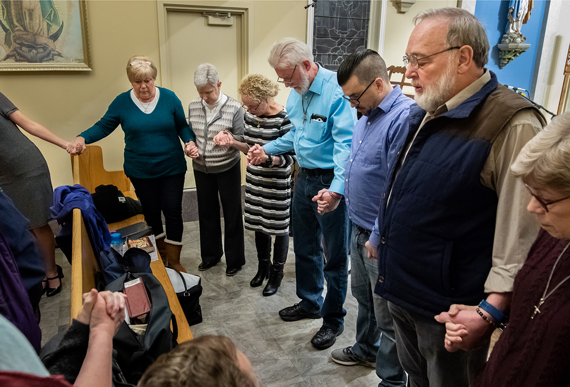 Deacon Ken Henning, right, led the choir in prayer before Mass for Jamie Schmidt at St. Anthony of Padua Church in High Ridge on Tuesday, Nov. 20, 2018. Schmidt was killed while shopping at the Catholic Supply store in west St. Louis County.