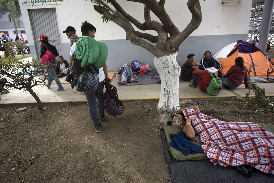 A man slept on the grounds of a sports facility in Tijuana, Mexico, set up for people arriving Nov. 15 in a caravan of Central American migrants at the U.S.-Mexico border. The shelter opened the previous night and had more than 750 people, but dozens more lined up outside waiting to enter.
