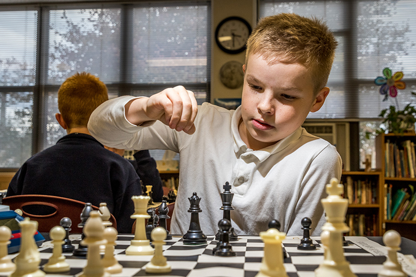 Jack Friedman, a fifth-grader at St. Peter School in Kirkwood, made his move during an after school tournament on Nov. 14. Instructors from the Chess Club of St. Louis offer weekly lessons to students, many of whom play in the CYC chess league.
